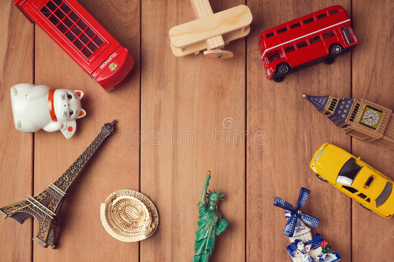 Travel and tourism concept with souvenirs from around the world. View from above royalty free stock image