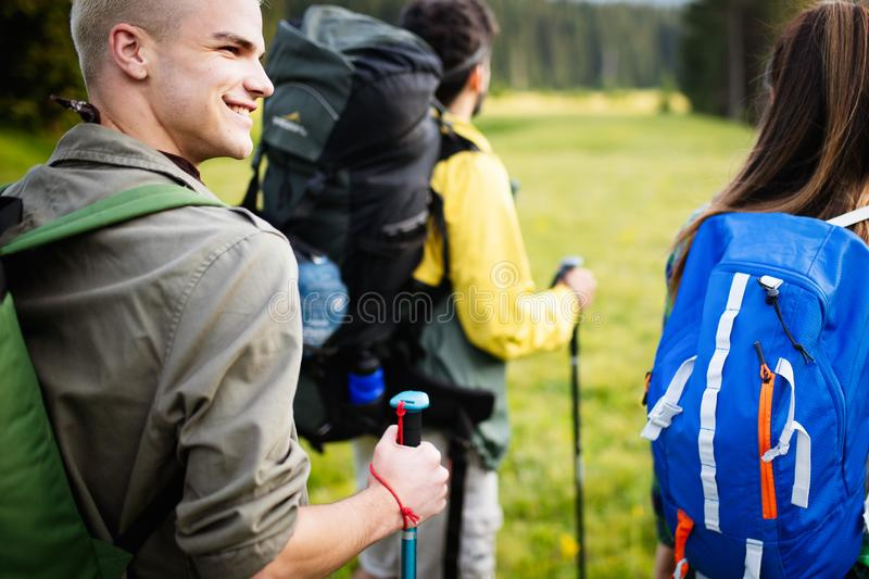 Travel, tourism, hike, gesture and people concept - group of smiling friends with backpacks stock photos