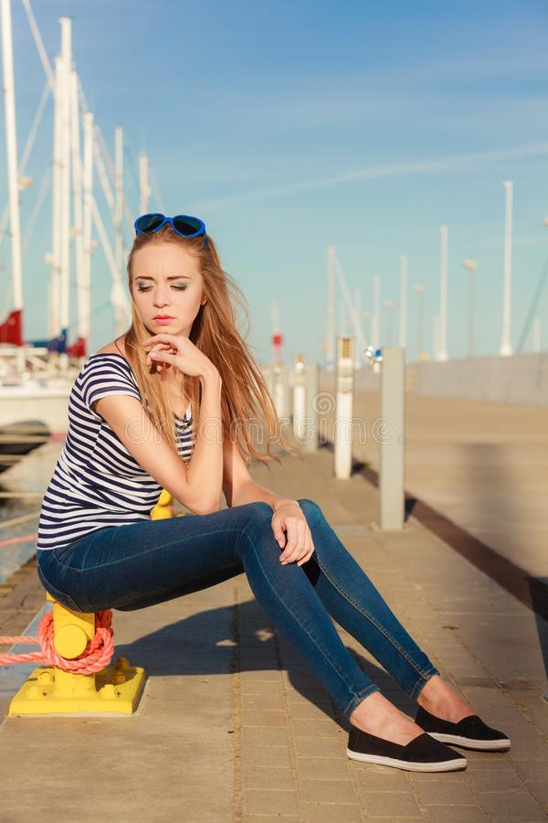 Woman in marina against yachts in port royalty free stock photos
