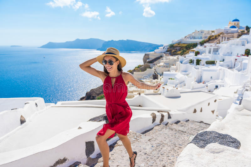 Travel Tourist Happy Woman Running Stairs Santorini. Greek Islands, Greece, Europe. Girl on summer vacation visiting famous tourist destination having fun stock image