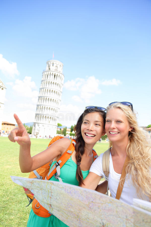 Travel tourists friends holding map in Pisa, Italy royalty free stock photos