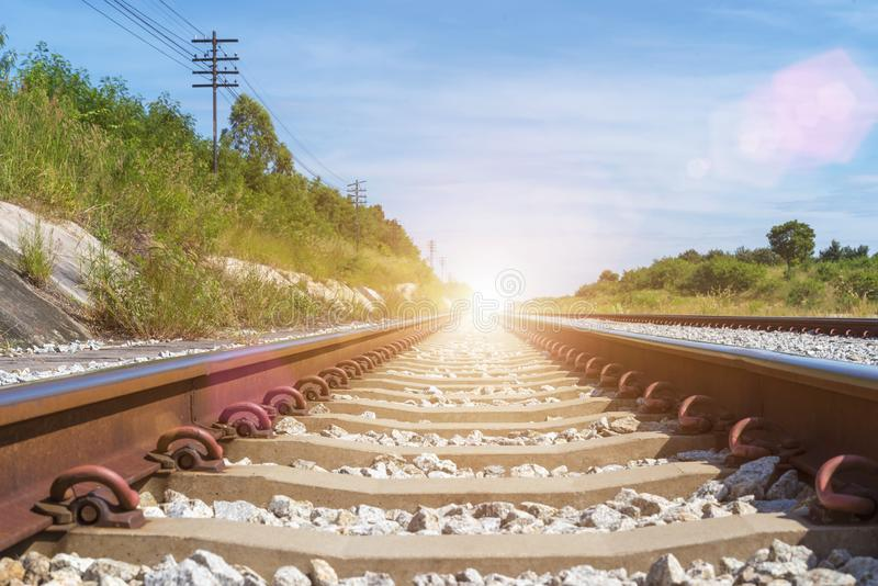 Travel and transportation background concept. Empty railway or railway tracks with blue sky at sunrise. Picture for add text. Message. Backdrop for design art stock image