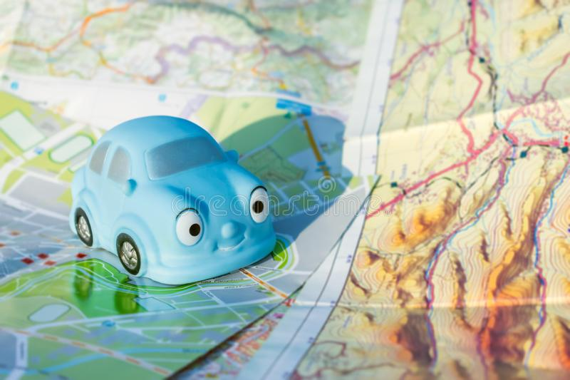 Travel, trip, journey, road, Go on an adventure concept. Close u. P of small blue toy car on different maps and tourist booklets stock photography