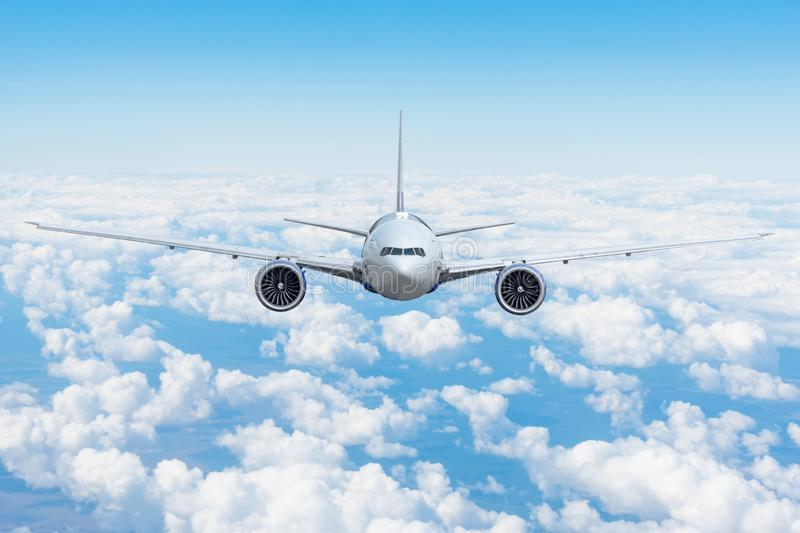 Travel trip vacation airplane is flying above the day clouds.  stock image