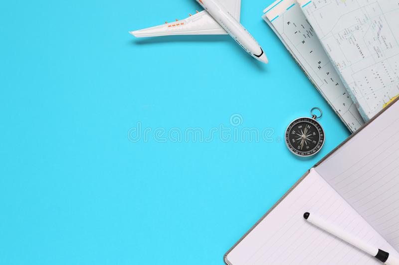 Travel , trip vacation, tourism mockup - compass, mobile phone, pen and toy airplane and touristic map on blue background. Copy sp royalty free stock images