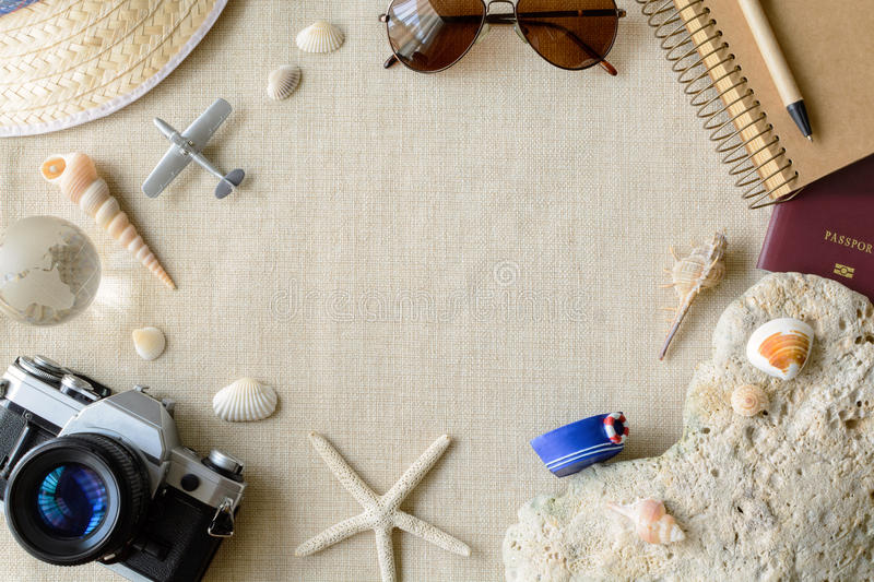 Travel and vacation accessories on sackcloth background. Summer concept with copy space stock image