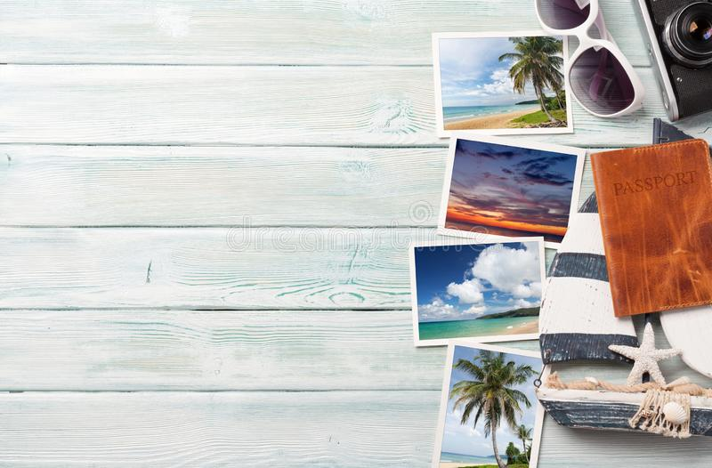 Travel vacation background concept with sunglasses, camera and weekend photos on wooden backdrop. Top view with copy space. Flat. Lay. All photos taken by me stock photo