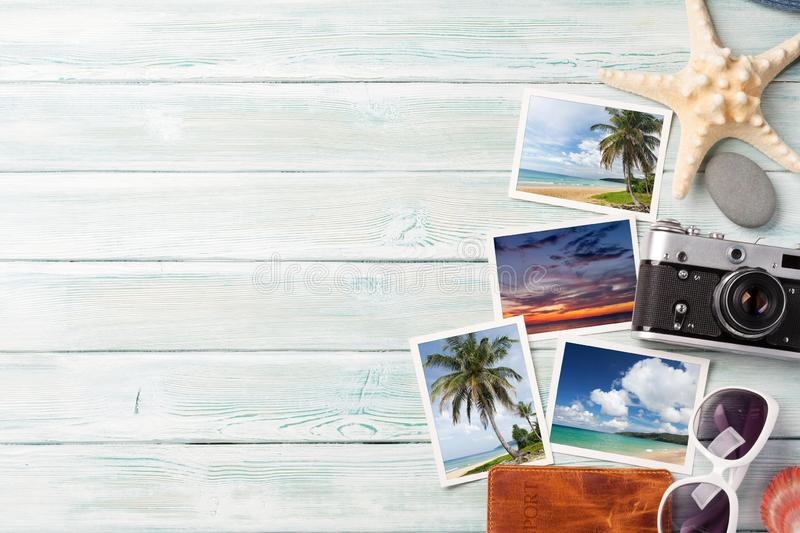 Travel vacation background concept with weekend photos on wooden backdrop. Top view with copy space. Flat lay. All photos taken by stock photos