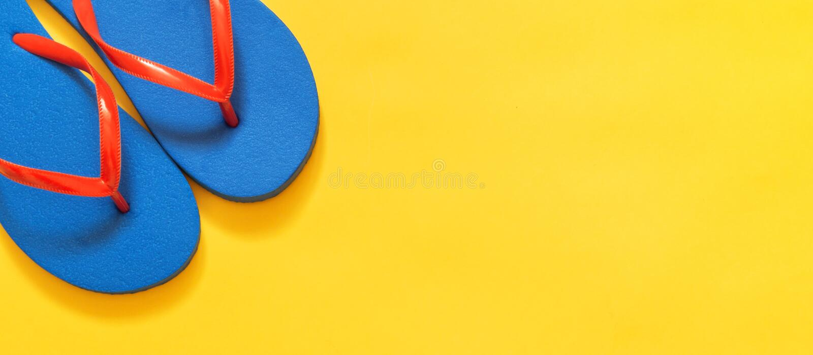 Travel vacation background. Flip flops on a yellow background. stock photos