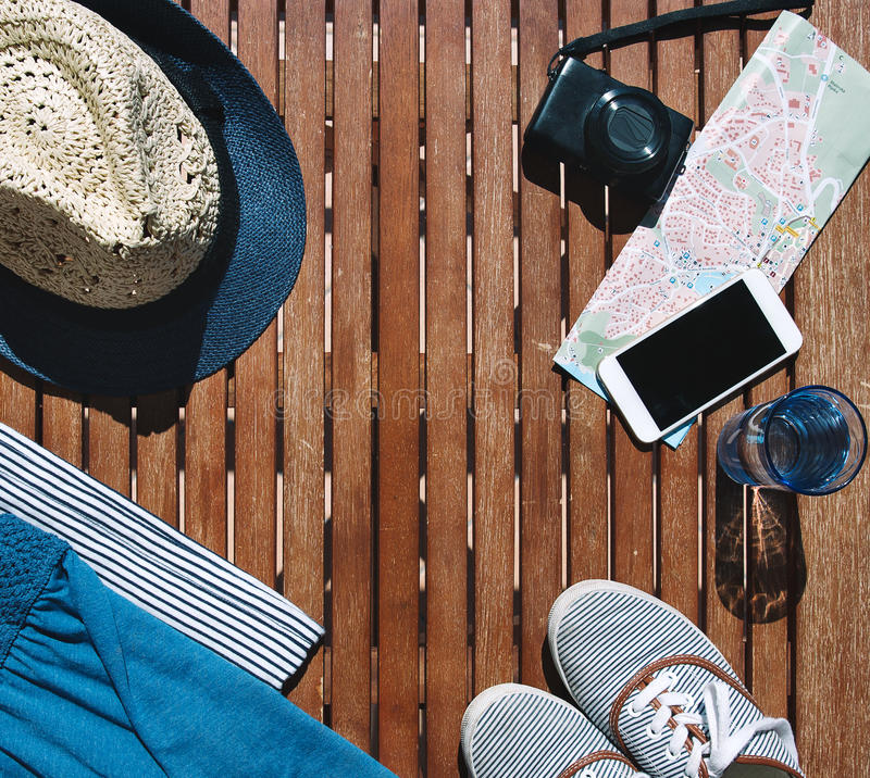 Travel, vacation concept. Summer outfit and travel stuff of traveler. royalty free stock photo