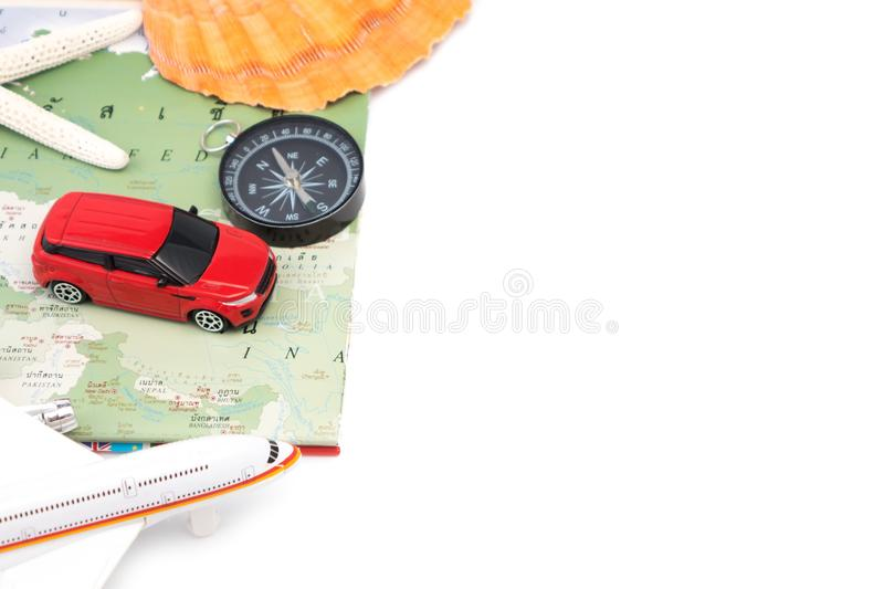 Travel and vacation items on white table stock photography