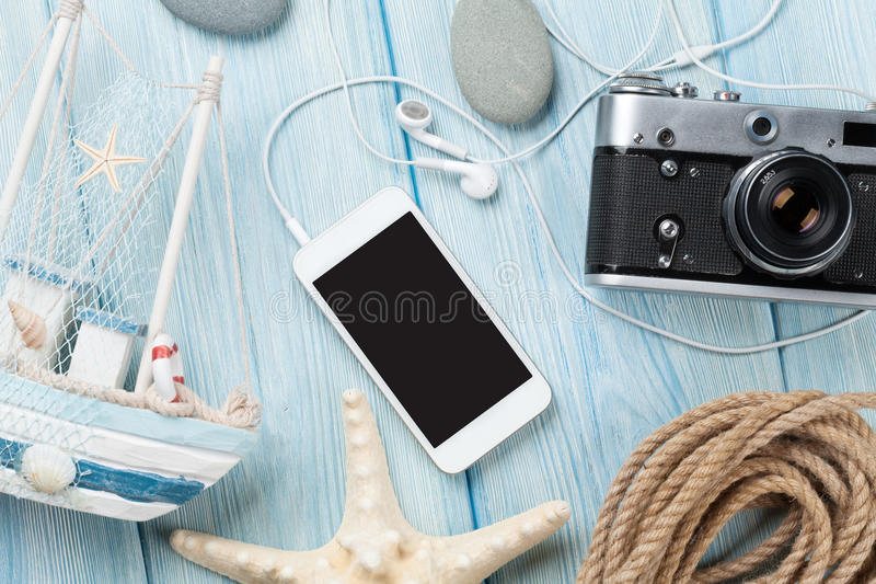 Travel and vacation items on wooden table stock image