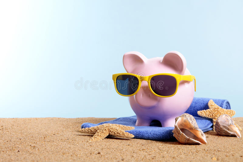 Travel vacation money, retirement plan, Piggy Bank on beach, copy space stock photography