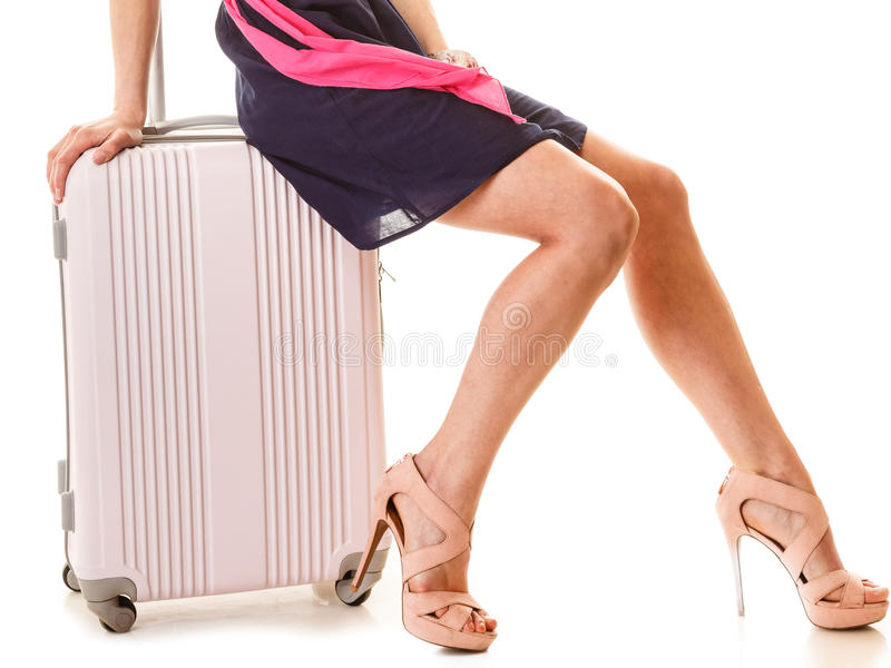 Travel and vacation. Woman with suitcase luggage bag. Travel vacation concept. summer fashion woman in voyage, female legs and pink suitcase luggage bag royalty free stock images