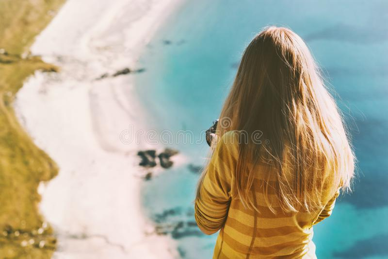 Travel vacations woman tourist standing above ocean royalty free stock photo