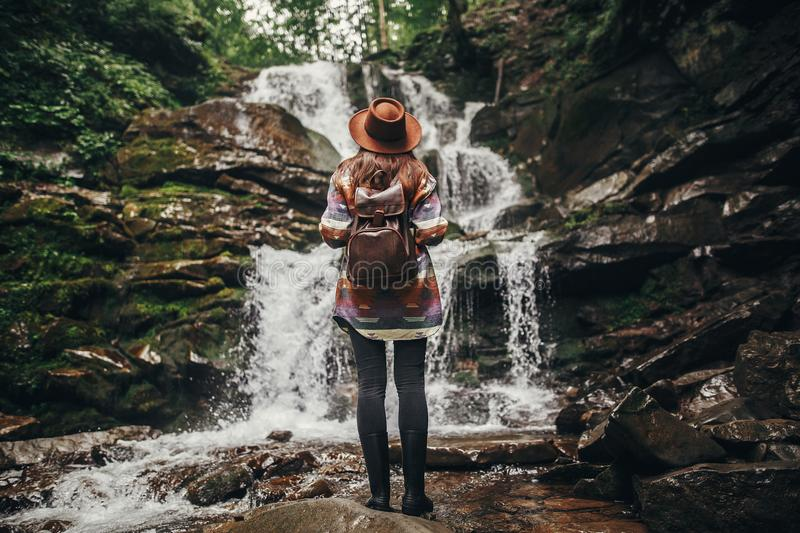 Travel and wanderlust concept. stylish hipster girl in hat with stock image