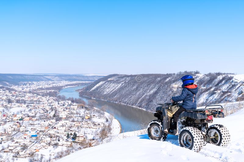 Travel in the winter on the ATV. Beautiful winter nature stock photo