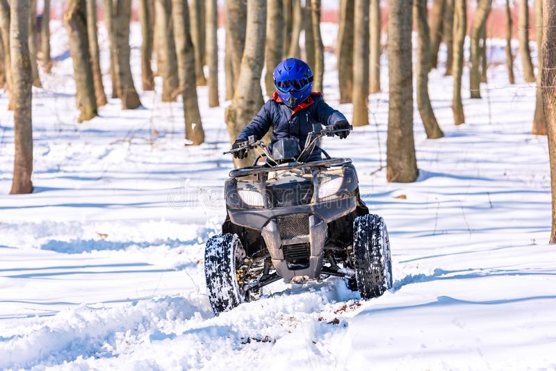 Travel in the winter on the ATV. Beautiful winter nature royalty free stock photography