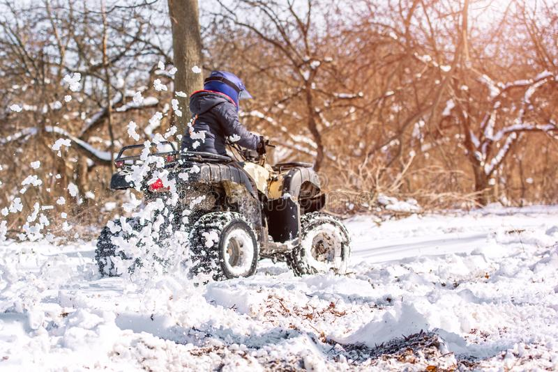 Travel in the winter on the ATV. Beautiful winter nature royalty free stock photo