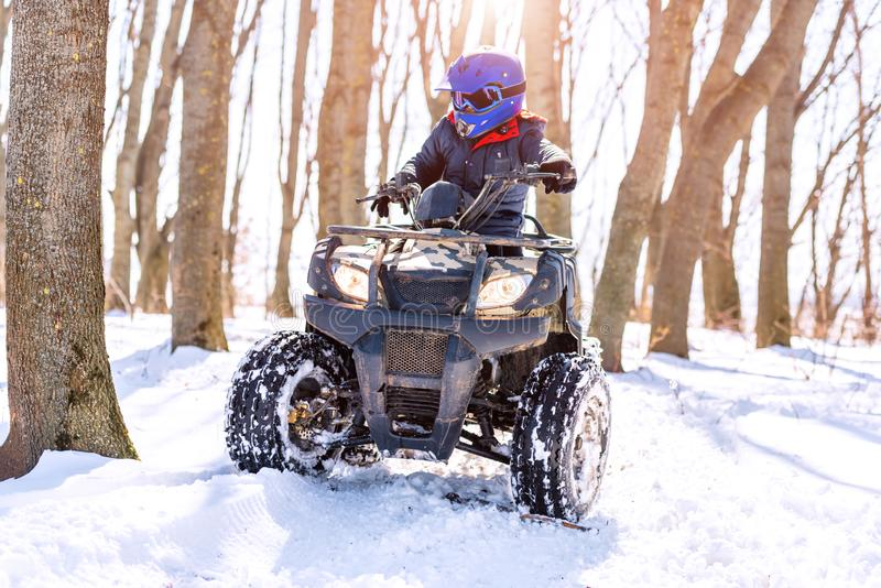 Travel in the winter on the ATV. Beautiful winter nature stock images