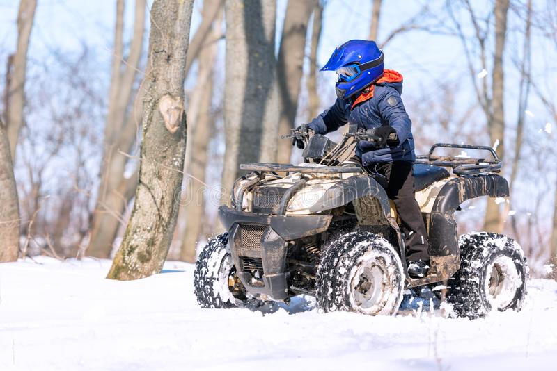 Travel in the winter on the ATV. Beautiful winter nature royalty free stock image