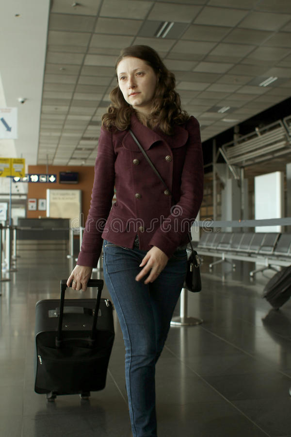Download Travel Woman In Airport Stock Photos - Image: 27737923