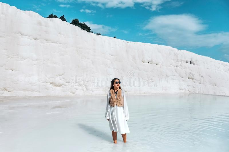 Travel woman enjoying Pamukkale tranvanter pools at ancient Hierapolis , Denizli stock image