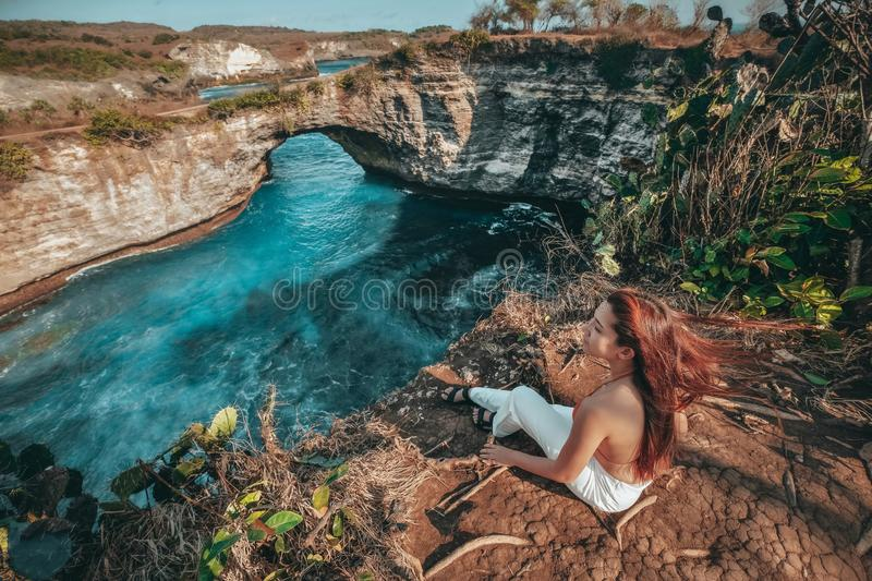 Travel woman looking view of broken beach, Nusa Penida island Bali ,Indonesia royalty free stock image