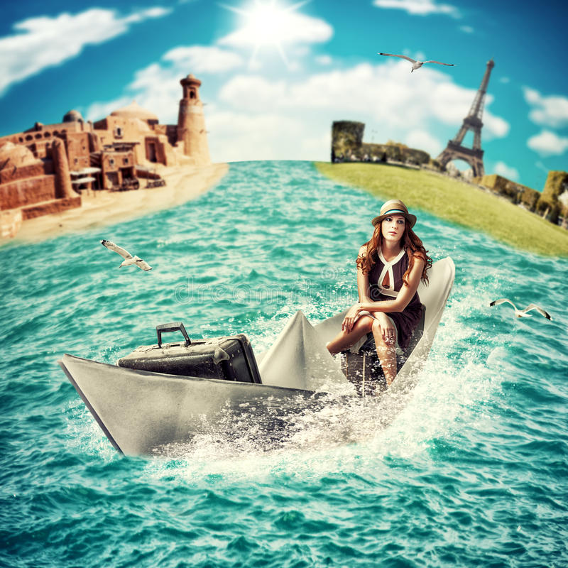 Travel. Woman with luggage on boat. Travel Concept - dreaming about sea ​​cruise around the world.Woman with luggage floats on the paper boat on