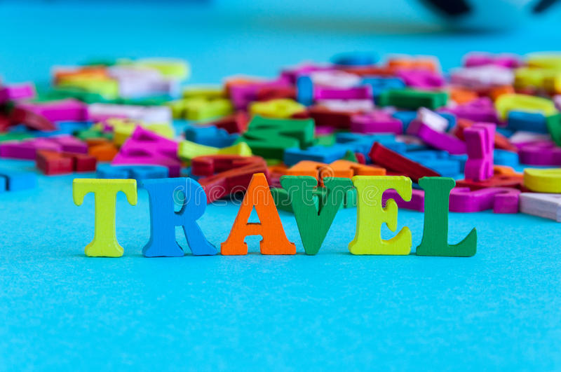 Travel - word composed of small colored letters on table. Vacation and Traveling illustration concept background.  royalty free stock photos