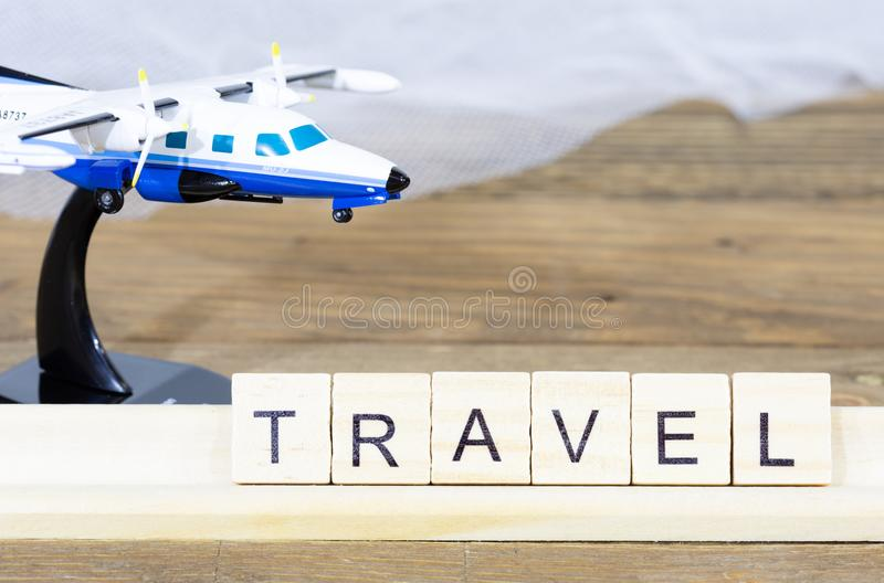 Travel written with words. Trip written with words next to an airplane royalty free stock images