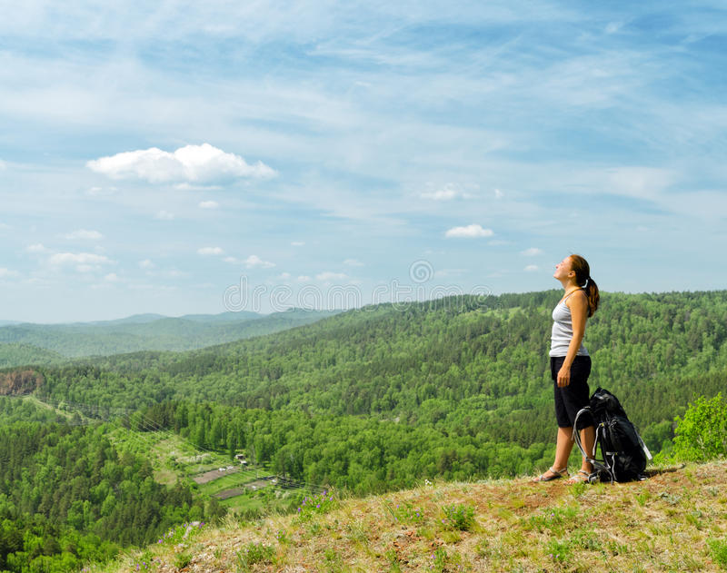 Young hiker on the hilltop.  stock photo