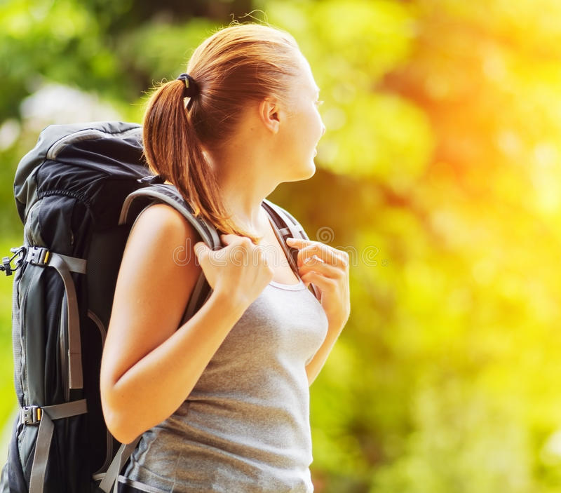 Young woman with backpack in a woods royalty free stock photos