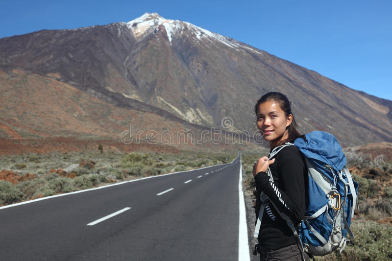 Traveler. / hiker hitchhiking on road side. Teide, Tenerife royalty free stock photos