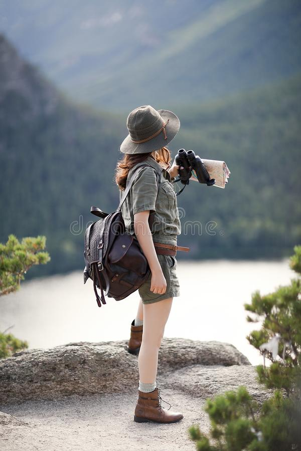 Traveler stands on a stone royalty free stock images