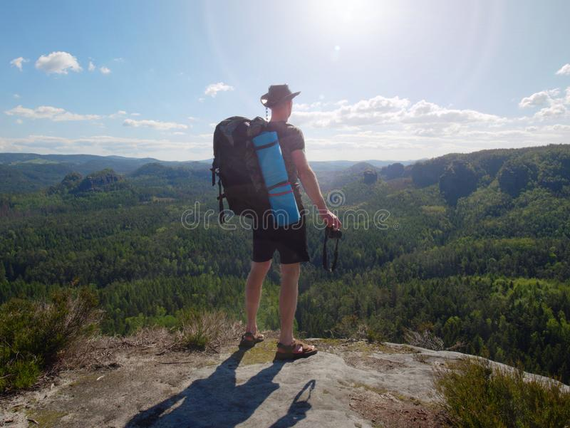 Traveler with backpack and camera in hands exploring nature royalty free stock images