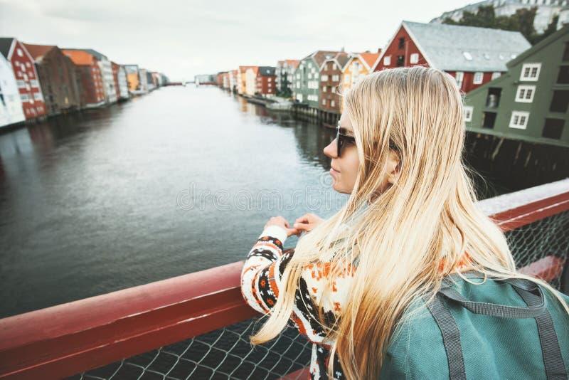 Traveler blonde woman sightseeing Trondheim city. On bridge in Norway Lifestyle vacations outdoor scandinavian landmarks architecture stock image