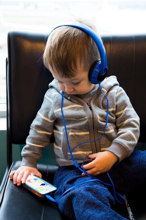 Download Traveler Boy Watching Movie On Phone Editorial Image - Image: 38708875