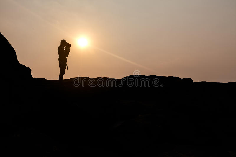 Traveler on cliff royalty free stock photography