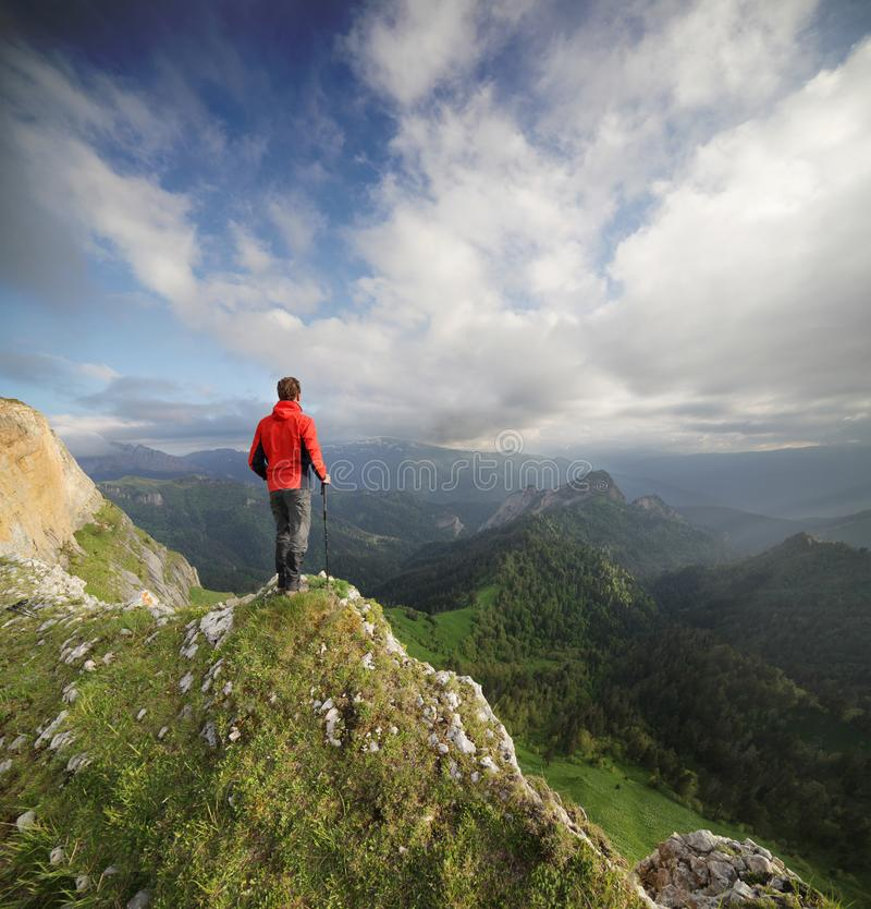 Traveler on the edge of rock. stock image