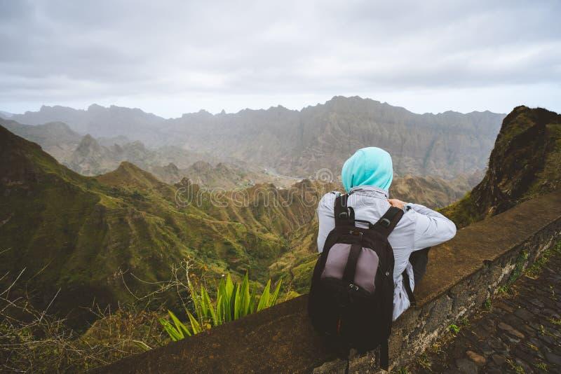 Traveler enjoying magnificent view of huge mountain range on Santo Antao island, Cape Verde. Traveler enjoying magnificent remote moment above huge mountain royalty free stock image
