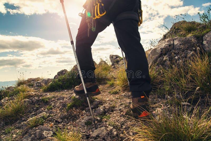 Traveler feet hiking. In mountains royalty free stock image