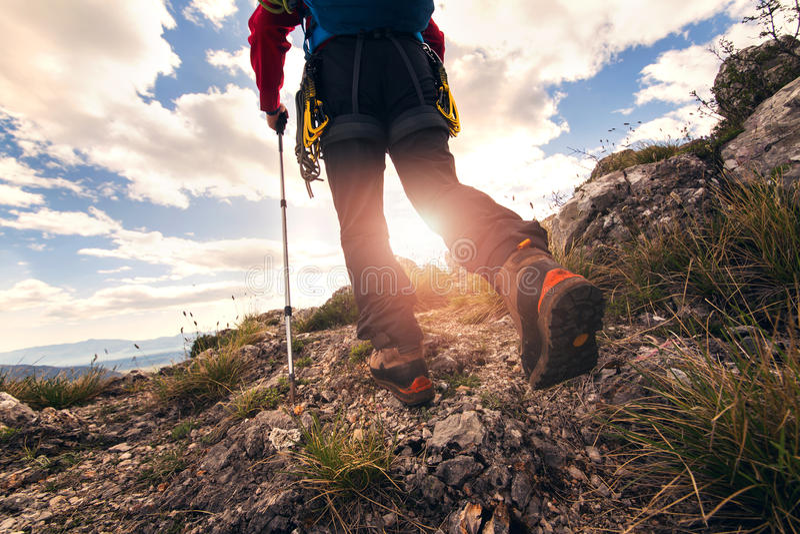 Traveler feet hiking. In mountains royalty free stock images