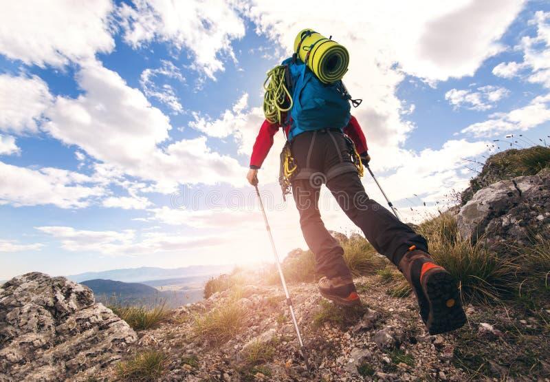 Traveler feet hiking in mountains. On sunset royalty free stock image