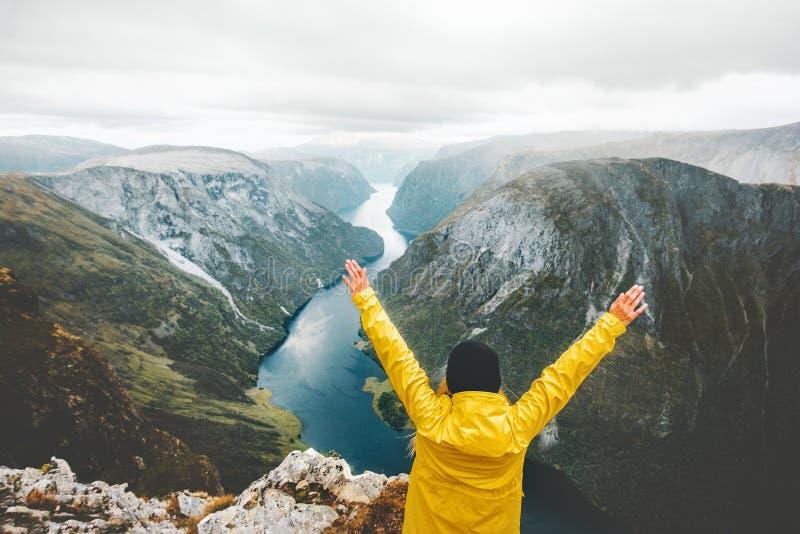 Traveler happy raised hands weekend getaway in mountains stock images