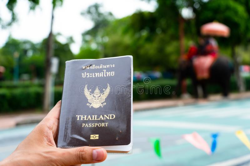 Traveler holding Thailand passport in Ayutthaya Thailand stock photos
