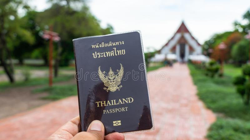 Traveler holding Thailand passport in Ayutthaya Thailand royalty free stock image