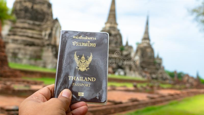 Traveler holding Thailand passport in Ayutthaya Thailand stock photo