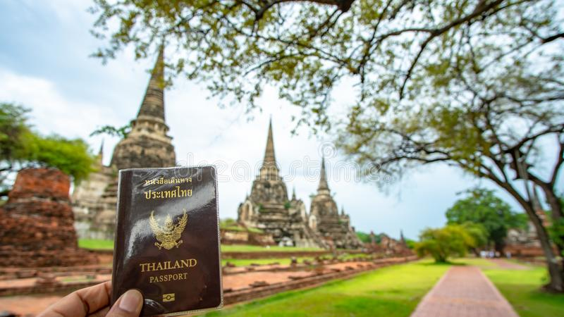 Traveler holding Thailand passport in Ayutthaya Thailand royalty free stock photo