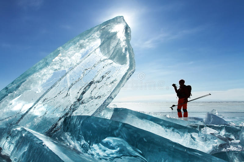 Traveler among Baikal ice. Traveler among Baikal natural ice royalty free stock images